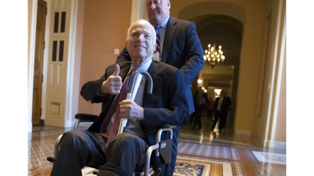 McCain says he's feeling well, vows return in January