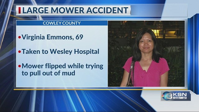 Woman injured after becoming pinned under mower